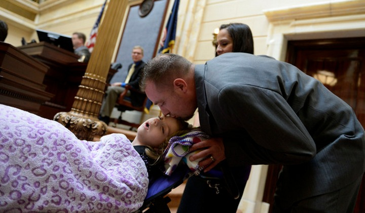 Catrina and Jeff Nelson with their daughter Charlee (Photo: Salt Lake Tribune/Francisco Kjolseth)