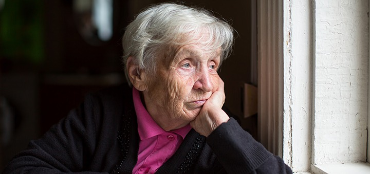 old lady looking at the window
